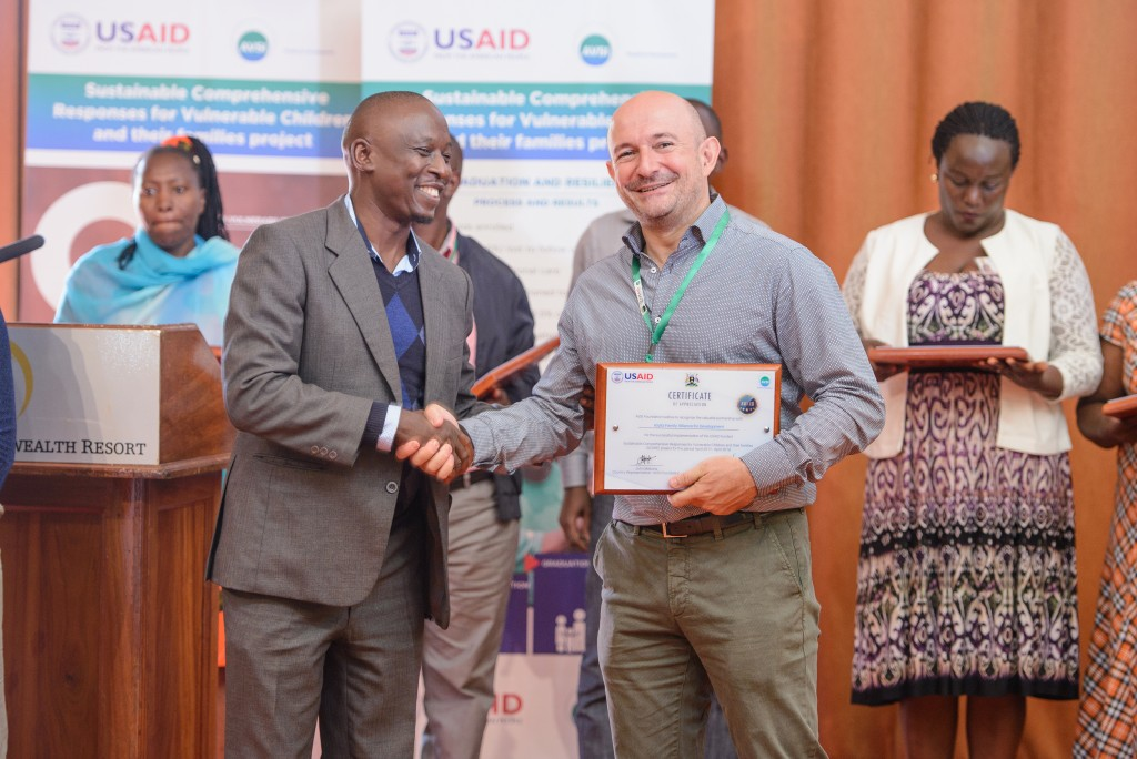 Bob receives an award for 'Best performing organisation for Wakiso district'